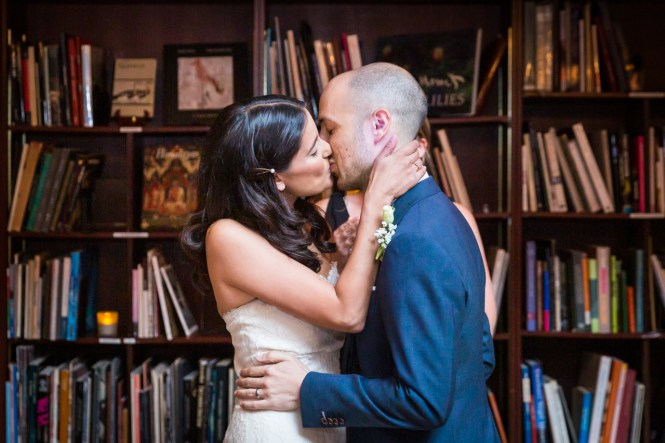 Bride and groom kissing for an article on non-floral centerpiece ideas