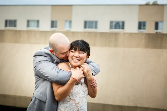 Groom hugging bride after traditional Korean pyebaek ceremony