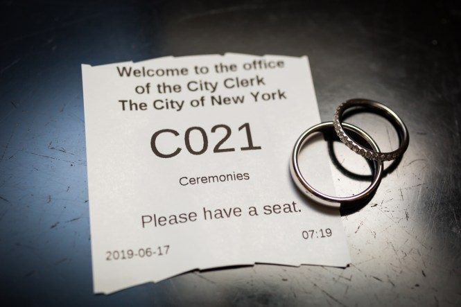Wedding rings with City Clerk's Office waiting ticket