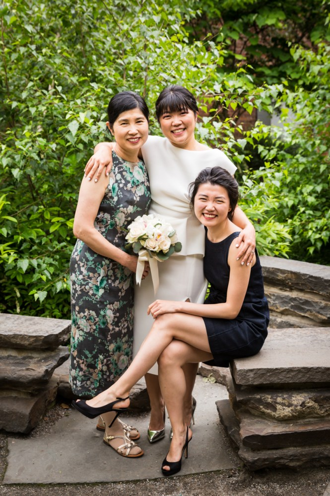 Bride, mother, and sister in Brooklyn Bridge Park