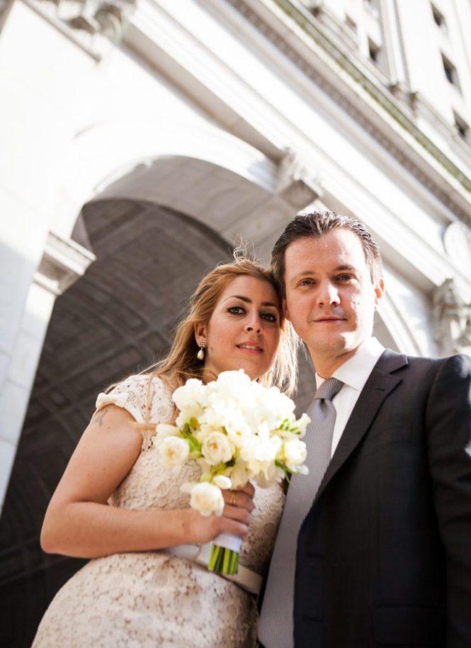 Bride and groom portrait after a Manhattan Marriage Bureau wedding, by NYC wedding photojournalist, Kelly Williams