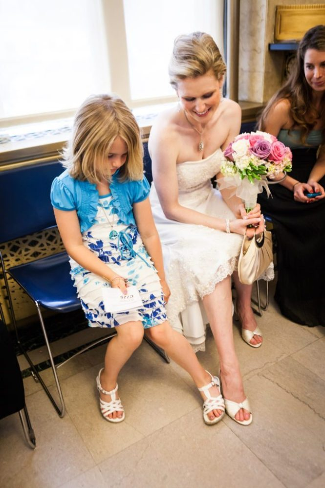 Comparing shoes before a NYC City Hall wedding, by Kelly Williams