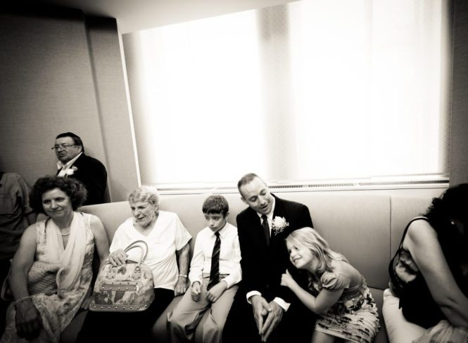 Guests waiting for a NYC City Hall wedding, by Kelly Williams