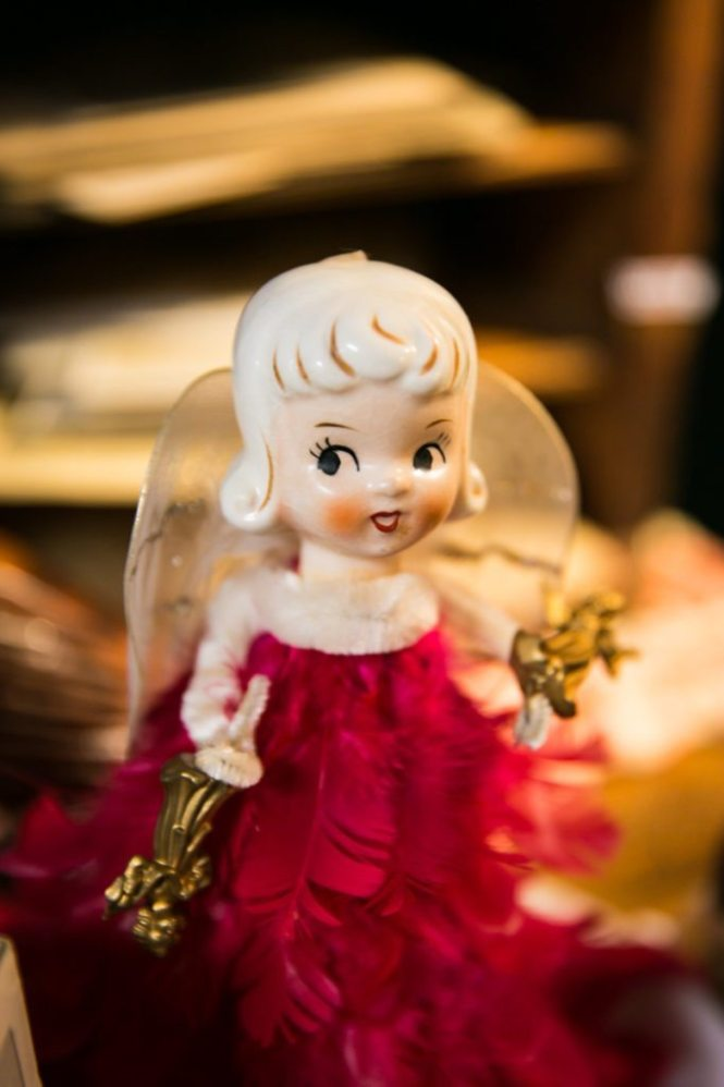 A kewpie doll angel for sale in an antiques store