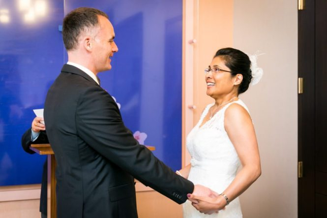 A couple getting married, by NYC City Hall wedding photographer, Kelly Williams