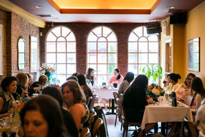 Guests mingling at  the bridal shower by Bay Ridge wedding photographer, Kelly Williams