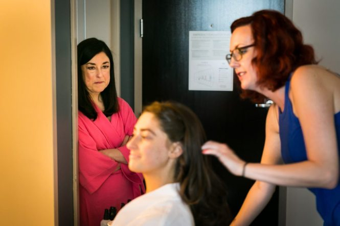 Bride getting ready, by Hoboken wedding photojournalist, Kelly Williams