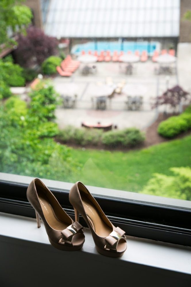 A bride's heels in a window