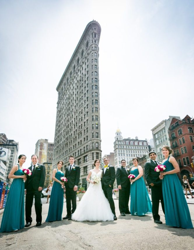 Bridal party at the Flatiron Building before a Columbus Citizens Foundation wedding by NYC wedding photojournalist, Kelly Williams