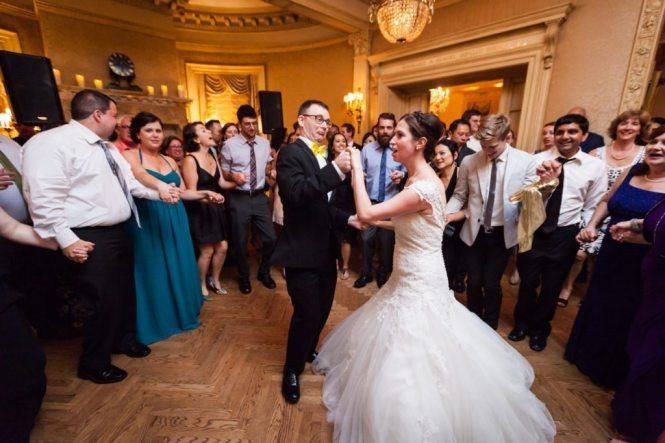 Tarantella dance at a Columbus Citizens Foundation wedding by NYC wedding photojournalist, Kelly Williams
