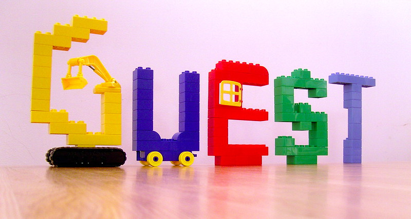 "The word ""Guest"" spelled with Lego."