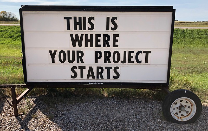 "Roadside sign with text ""This is where your project starts"""