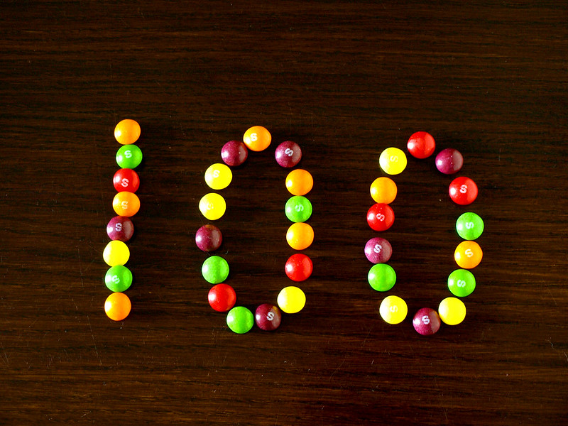 The number 100 created with Skittles candies.