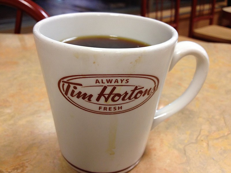 Picture of a Tim Hortons coffee mug with black coffee.