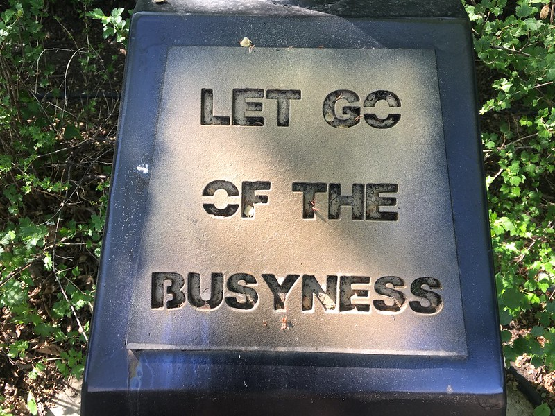 "Plaque that reads ""Let Go of The Busyness"""