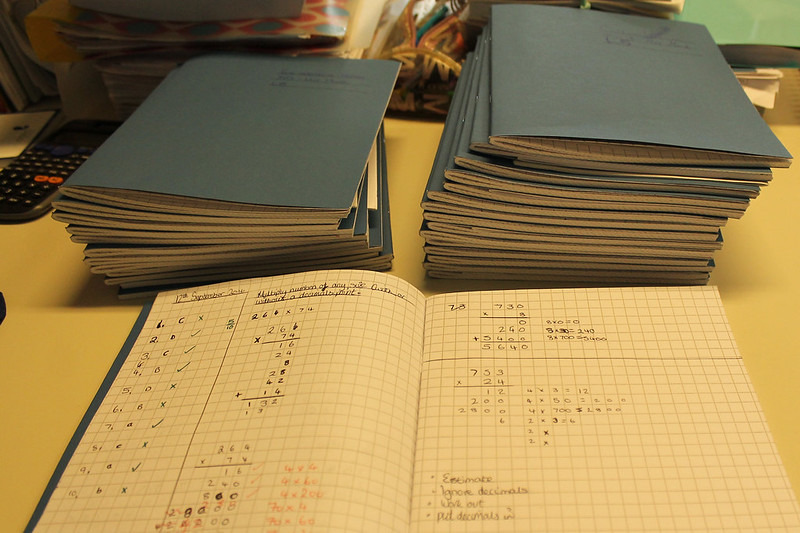 Stack of lab books in process of marking.
