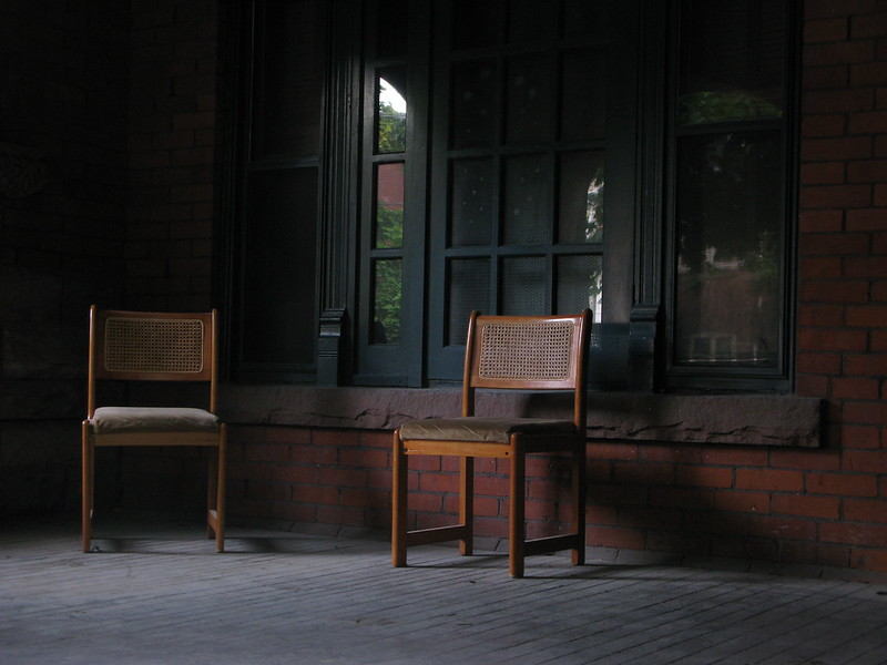 Picture of two chairs positioned for conversation but without people.