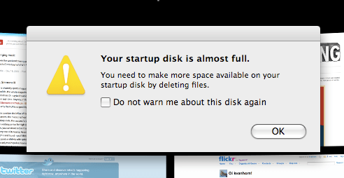 A computer warning message about the startup disk being almost full.