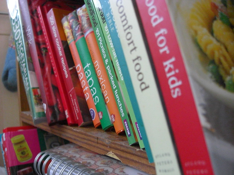 Cookbooks on a shelf.