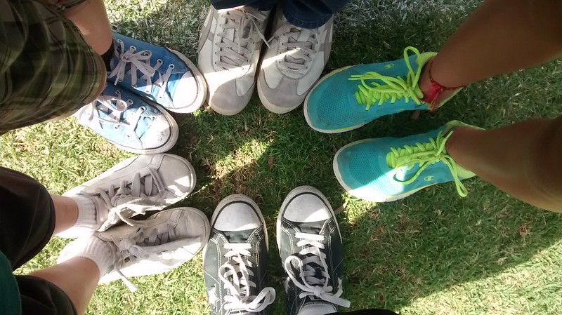 Photo of five pairs of tennis shoes.