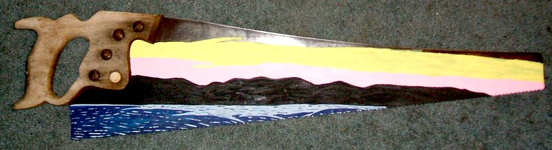 Antique handsaw with a painting of ocean (blue), mountains (black) and sky (pink and yellow).