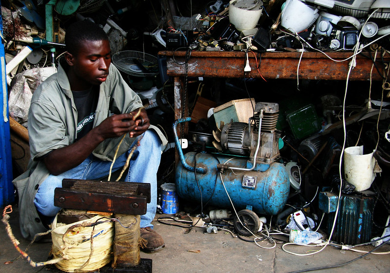 An electrical repairman in his incredibly cluttered shop, Koforidua, Ghana, West Africa