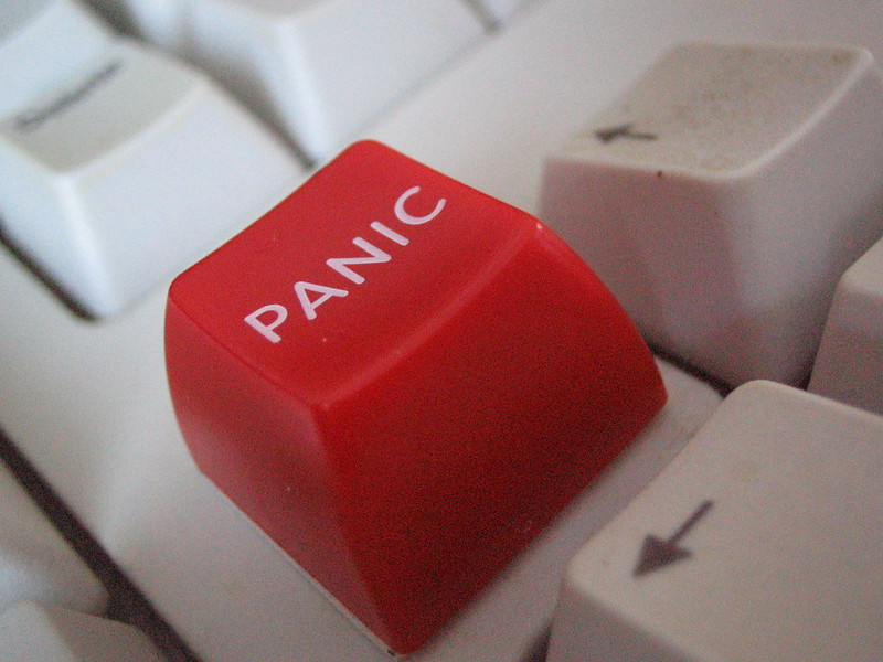 """Image of a special red key on a white keyboard labeled """"PANIC"""""""