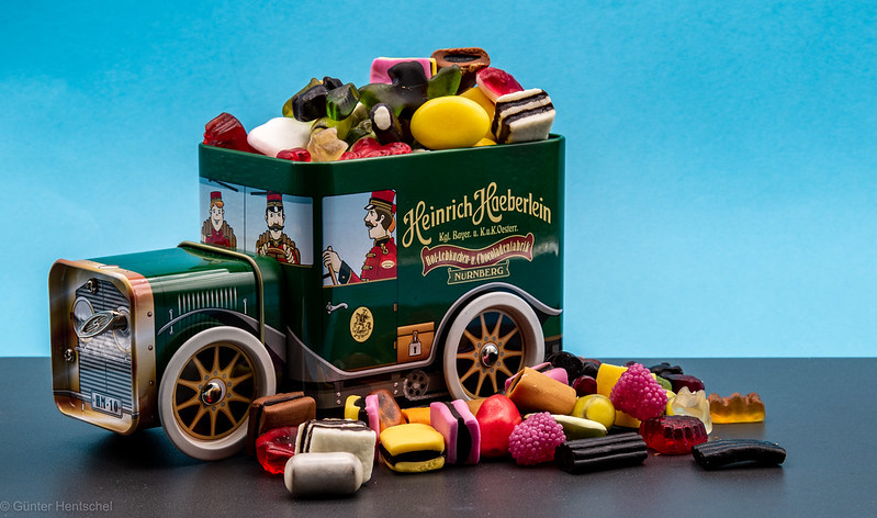 """A candy tin truck """"Heinrich Haeberlein"""" overflowing with candy."""