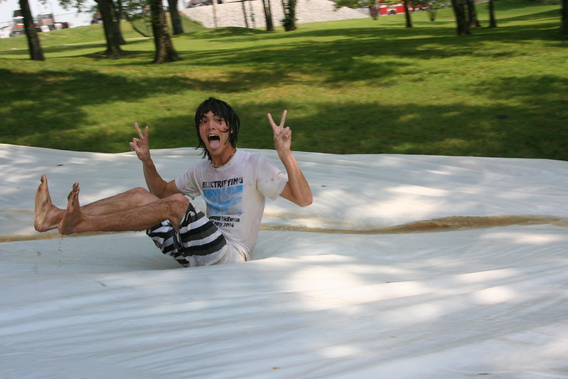 """Image of a youth on a """"Slip 'n Slide"""""""