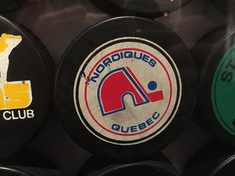A puck with a Quebec Nordiques logo.