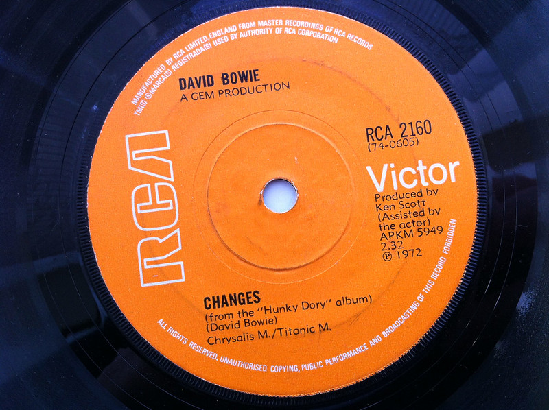 """Orange label of a 45 of David Bowie """"Changes"""" from 1972 from the """"Hunky Dory"""" album."""