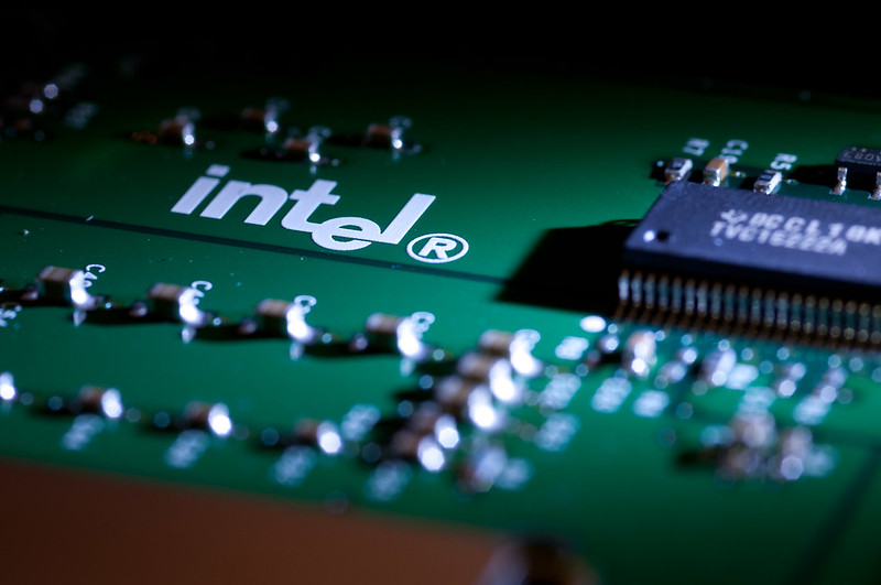 Close up of whate appears to be an Intel motherboard, Intel logo in white the focus of the shot.