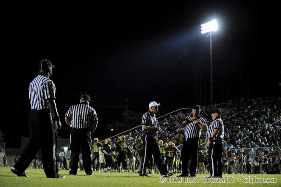 Referees during a Griffin High School football game at Memorial Stadium.