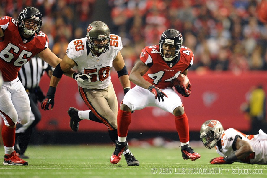 Atlanta Falcons fullback Jason Snelling (44) carries the ball against the Tampa Bay Buccaneers during the first half at the Georgia Dome.