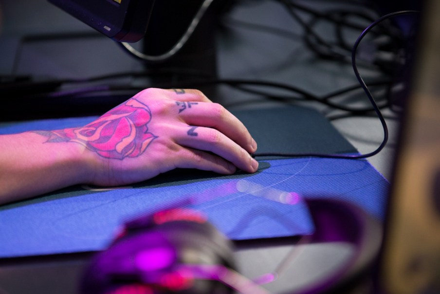The hand of Lincoln Lau, whose gamer tag is fnx, as he warms up.