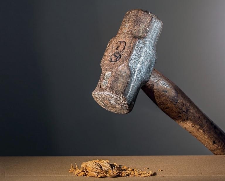 old sledgehammer resting on table