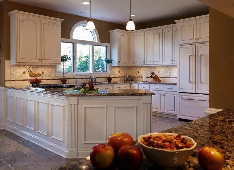 Single Arch or Cathedral (aka White Cathedral) kitchen cabinet door is a popular style, featuring wooden door profile with a single arch at the top.