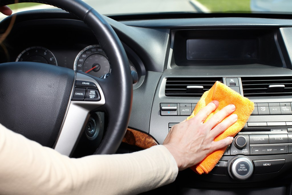 Hand cleaning car with cloth