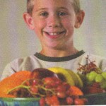 boy and fruit