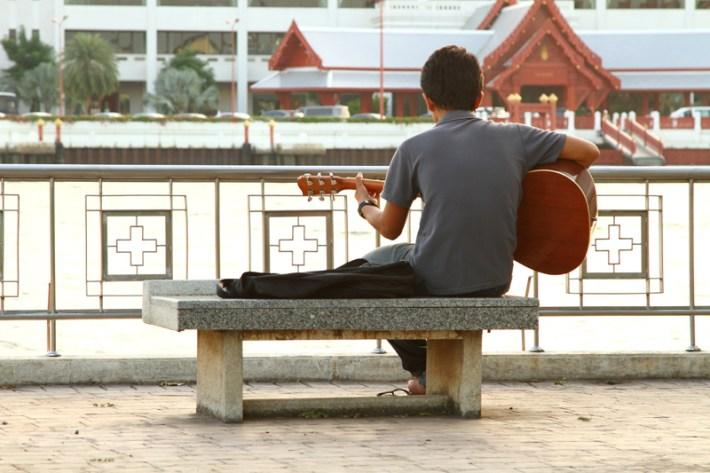 Little street musician in Thailand