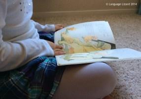 kid reading bilingual book