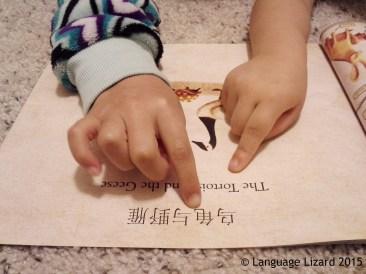 children reading bilingual book