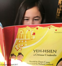 Child reading Chinese Cinderella story