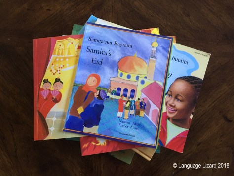 stack of multicultural bilingual children's books