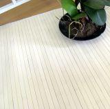 Detalle de la alfombra blanca