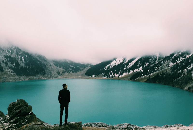 Man Looking out over a lake