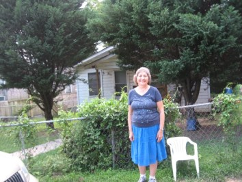 Janet standing where Lilly Ann's house would have stood in Natchez. The house in the photo is not Lilly Ann's house.