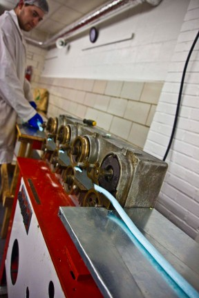 The candy is still warm enough to flow smoothly through the rope sizers, exiting at the correct diameter.