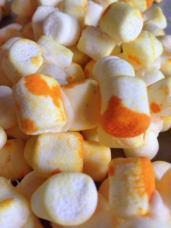 marshmallows and yellow food coloring