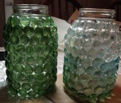 On the left, the white silicone jar, with a more matte look. On the right, clear gems with clear silicone.